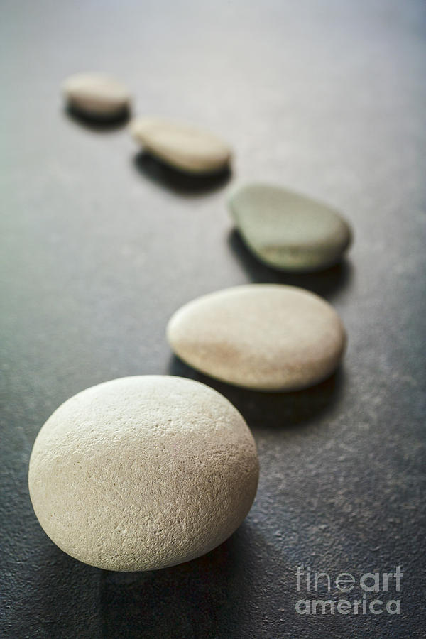 Stone Photograph - Curving Line Of Grey Pebbles On Dark Background by Colin and Linda McKie