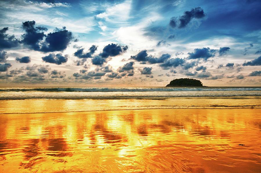 Dramatic Sunset Over Empty Beach Photograph by Aleksandargeorgiev