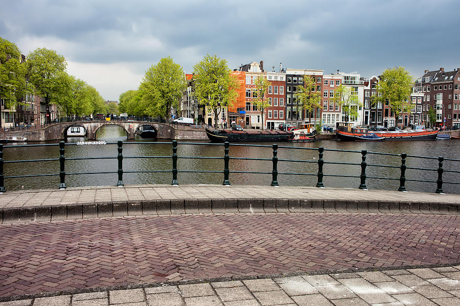 Amsterdam Photograph - Dutch Houses By The Amstel River In Amsterdam by Artur Bogacki