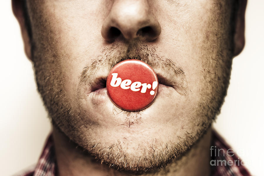 Face Of A Man With Beer Badge Photograph