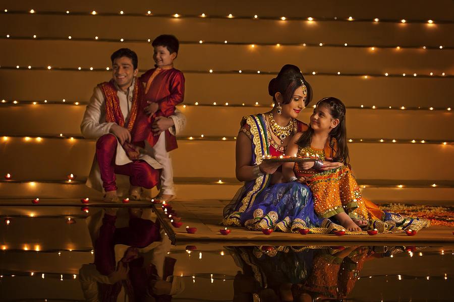 Family arranging diyas Photograph by Hemant Mehta
