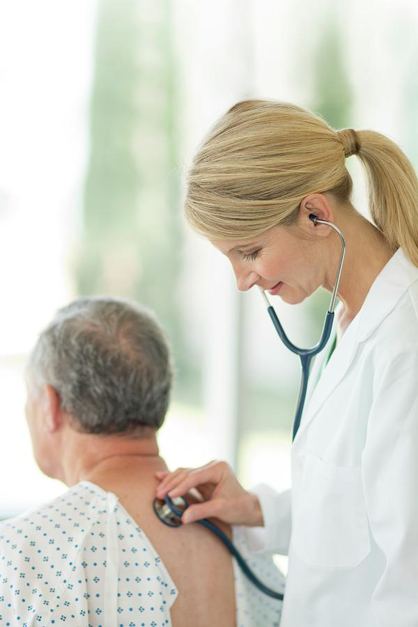 Female Doctor Using Stethoscope On Male Patient Photograph ...Doctor Stethoscope Comment