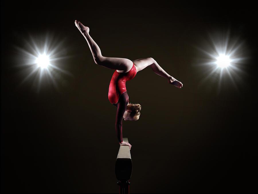 Female Gymnast On Balancing Beam Photograph by Mike Harrington