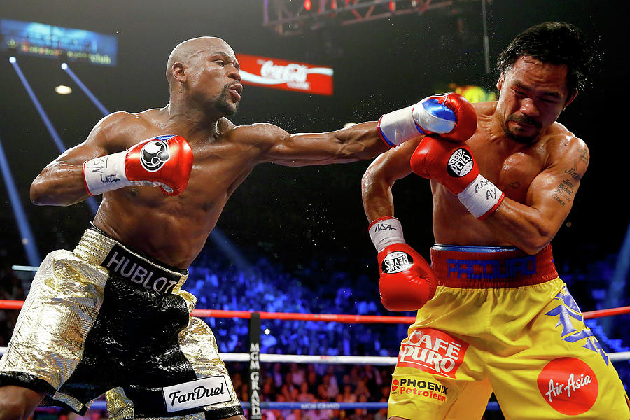Floyd Mayweather Jr. V Manny Pacquiao Photograph by Al Bello
