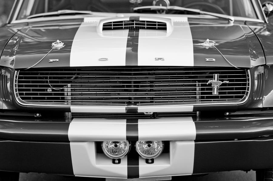Muscle Car Photograph - Ford Mustang Grille Emblem by Jill Reger