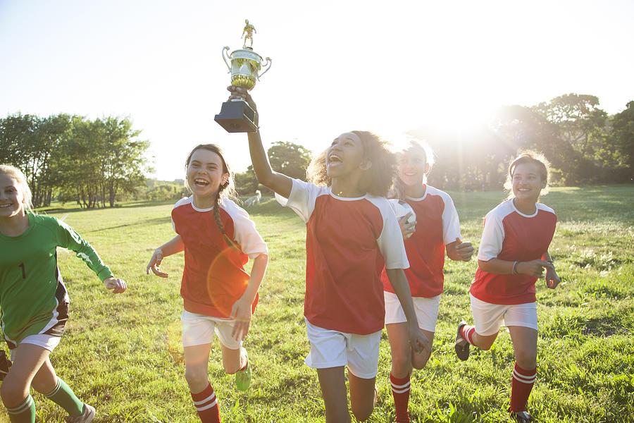 Girls soccer team celebrating Photograph by Alistair Berg