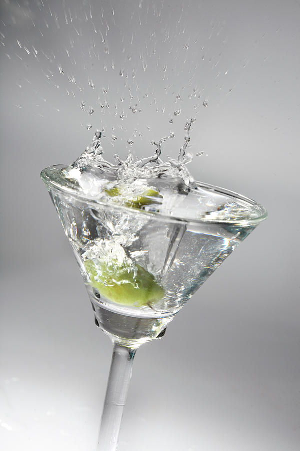 Green Olive In Martini Photograph by Visage