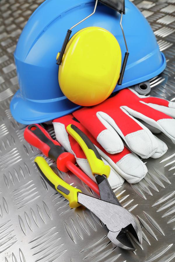 Clothing Photograph - Hardhat And Tools by Christian Lagerek/science Photo Library