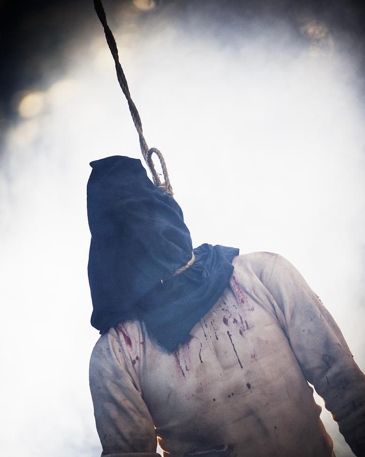 Hooded Hanging Man. Photograph by Ron Koeberer