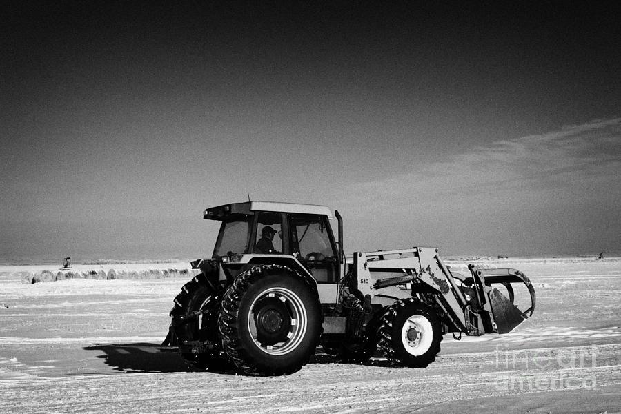 International Photograph - international 5140 tractor with front end loader on frozen field Forget Saskatchewan Canada by Joe Fox