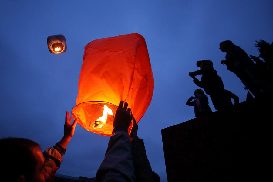 Lantern Paper Photograph - Launching Wish Lanterns by Science Photo Library