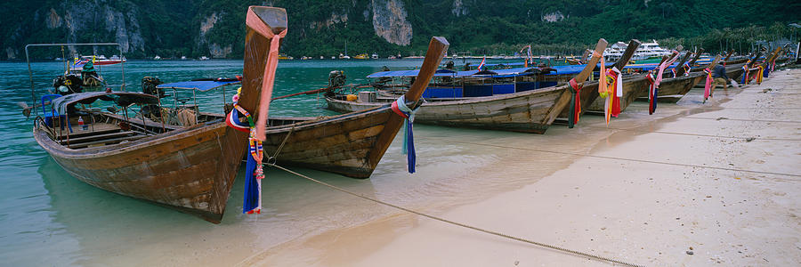 Color Image Photograph - Longtail Boats Moored On The Beach by Panoramic Images