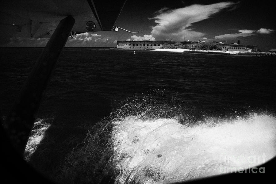 Coming Photograph - Looking Out Of Seaplane Window Landing On The Water Next To Fort Jefferson Garden Key Dry Tortugas F by Joe Fox