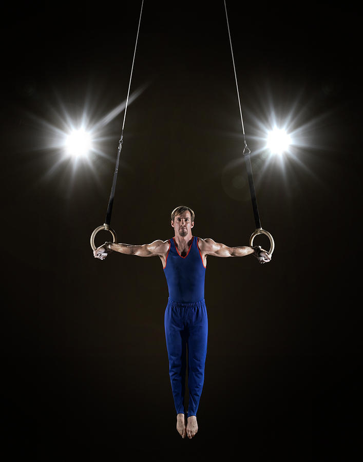Male Gymnast On Rings Photograph by Mike Harrington