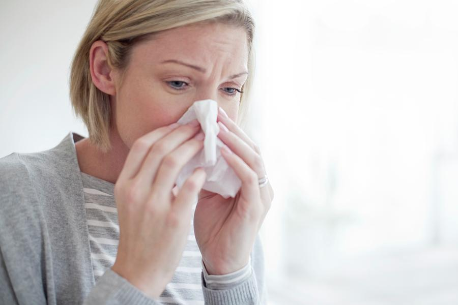 Indoors Photograph - Mid Adult Woman Blowing Her Nose by Science Photo Library