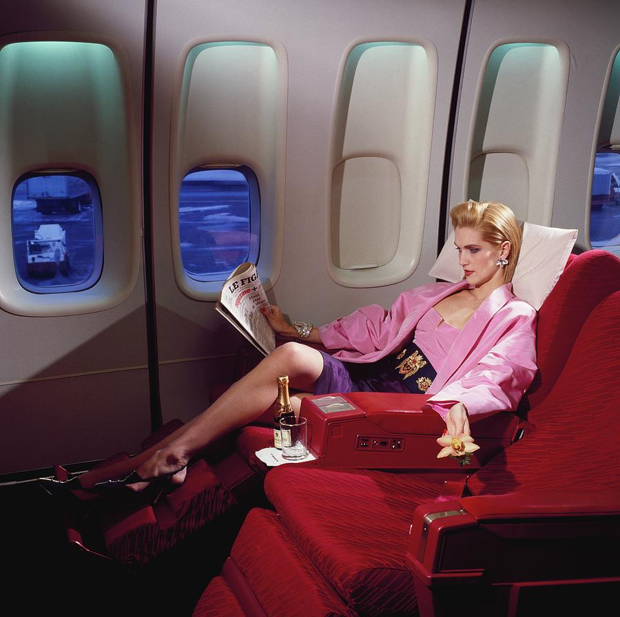Model Wearing Pink Jacket On Airplane Photograph by Horst P. Horst