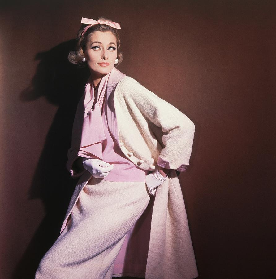 Model Wearing White Coat Over Pink Blouse Photograph by Horst P. Horst
