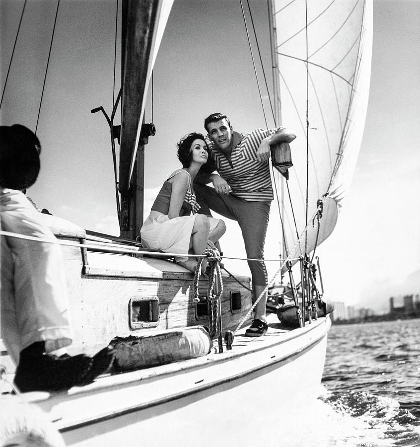 Models On A Sailboat Photograph by Richard Waite