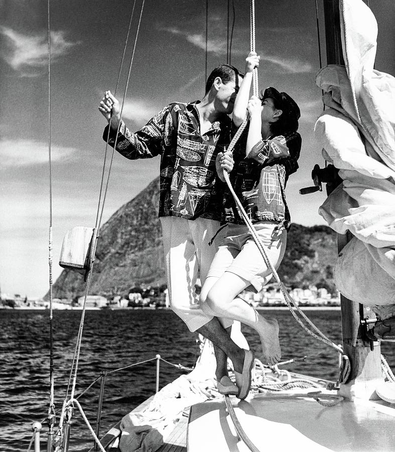 Models Wearing A Bennett Shirts On A Sailboat 1 Photograph by Richard Waite