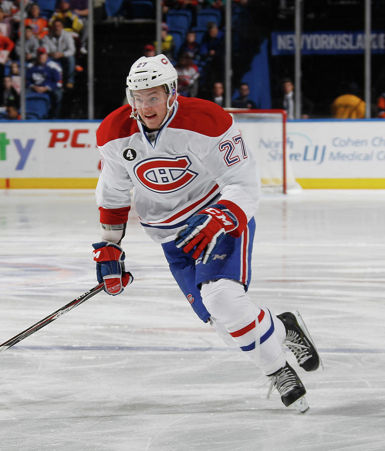 Montreal Canadiens V New York Islanders Photograph by Bruce Bennett