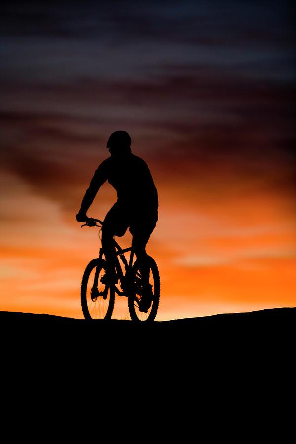 Adventure Photograph - Mountain Biker At Sunset, Moab, Utah by Whit Richardson
