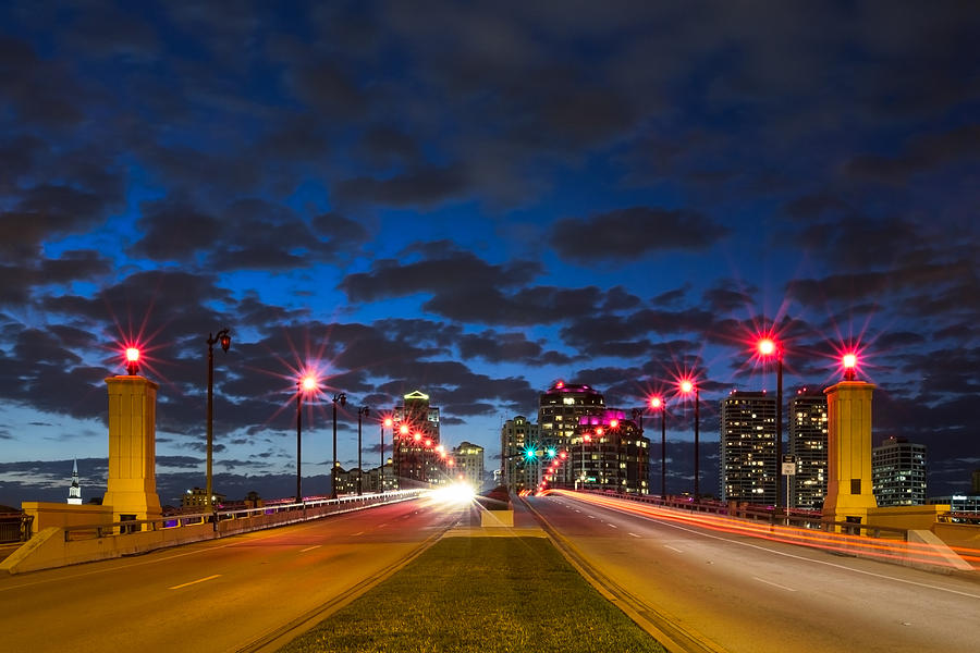 Clouds Photograph - Night Lights by Debra and Dave Vanderlaan