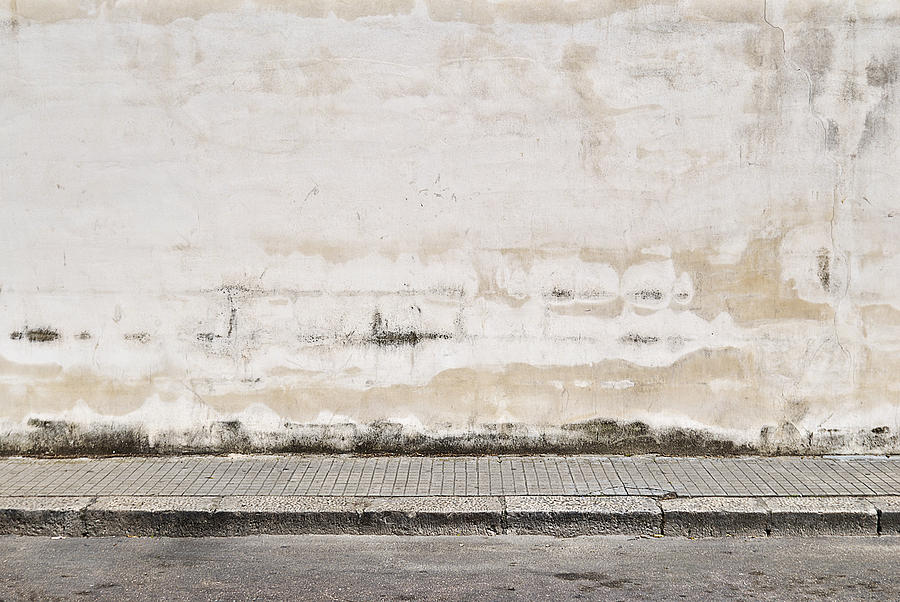 Old concrete grunge wall with sidewalk Photograph by Ilbusca