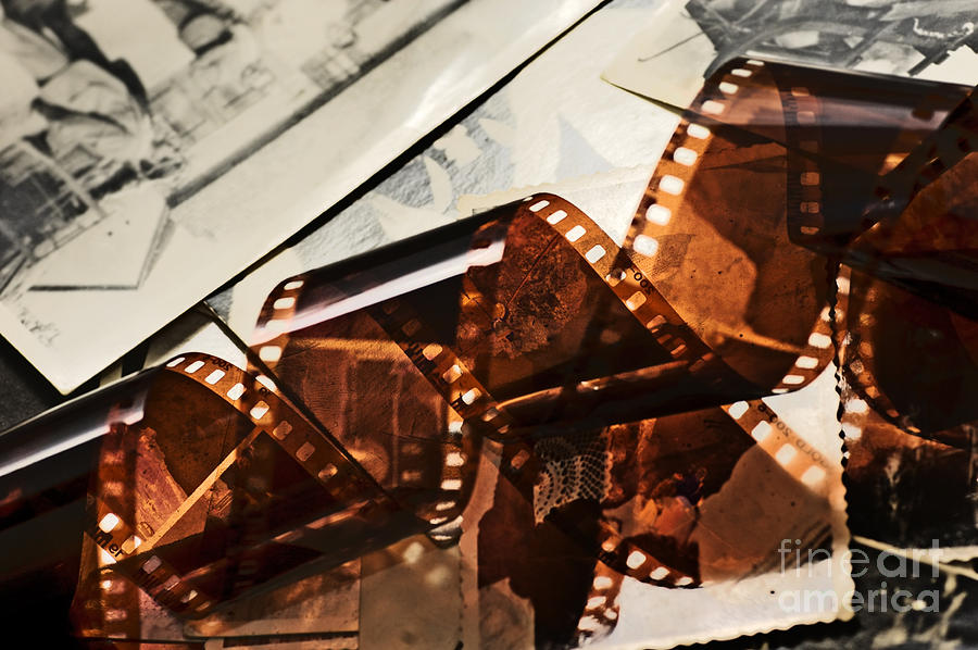 Old Film Strip And Photos Background Photograph