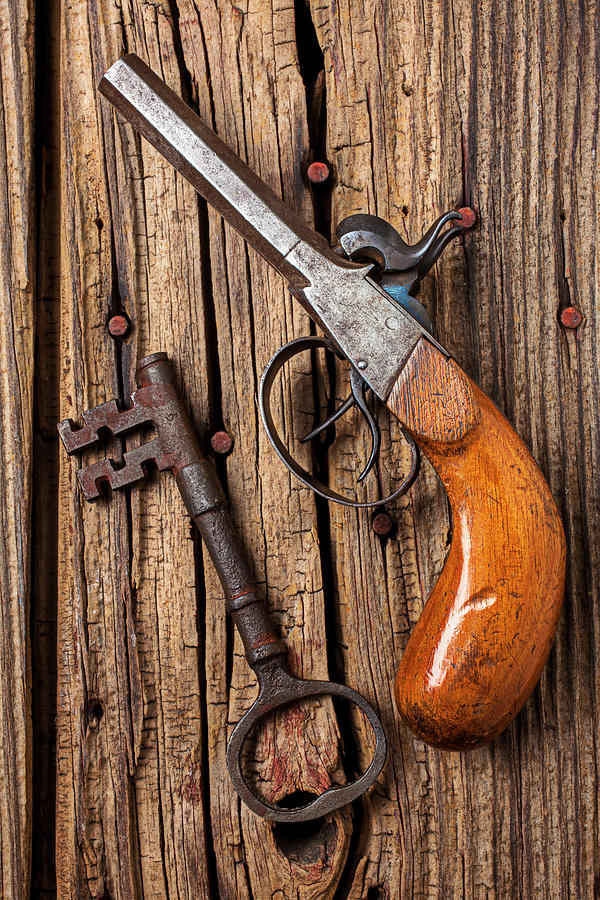 Old Pistol And Skeleton Key Photograph by Garry Gay