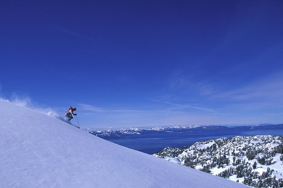 Action Photograph - One Woman Skiing In Powder High by Corey Rich