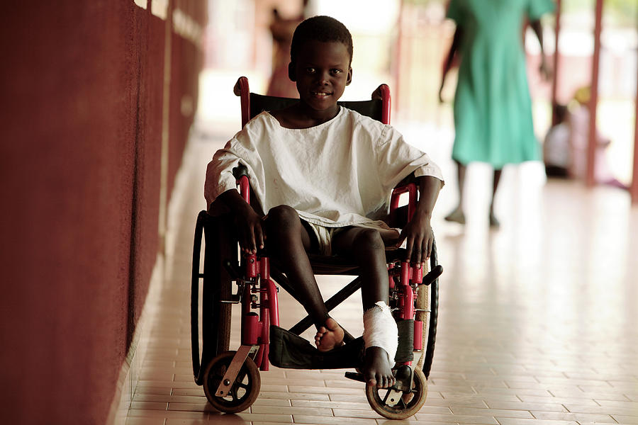Wheelchair Photograph - Patient In A Wheelchair by Mauro Fermariello/science Photo Library