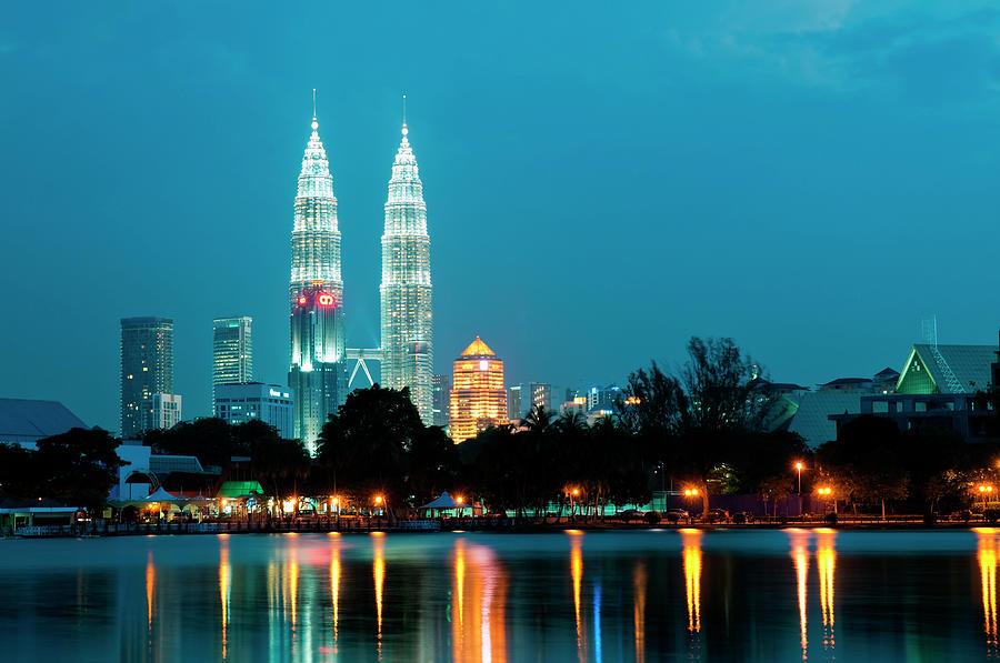 Petronas Towers And Lake Titiwangsa Photograph by Anders Blomqvist