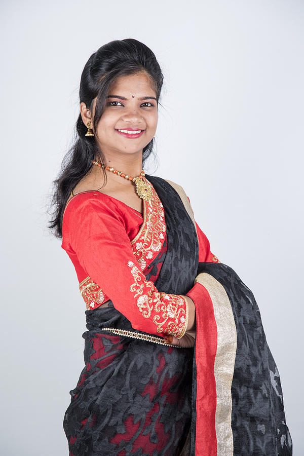 016727844d Portrait Of Beautiful Indian Girl , Happy Young Beautiful Traditional Indian  Woman In Saree. Photograph