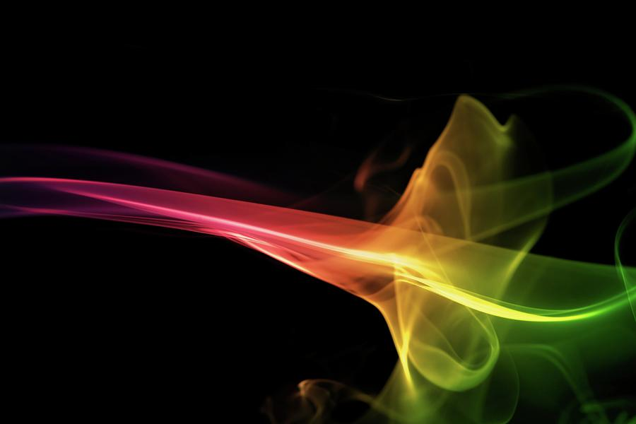 Rainbow Smoke On A Black Background Photograph by Gm Stock Films