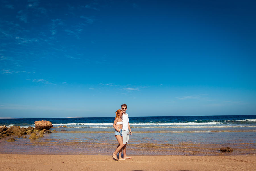 Romantic Young Couple On The Beach Photograph