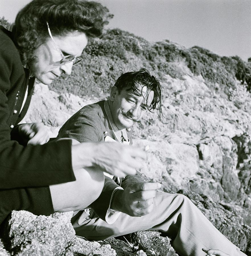 Salvador And Gala Dali On Rocks Photograph by Horst P. Horst