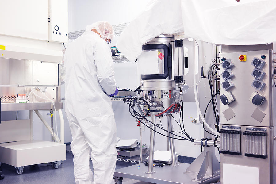 Scientist Working In A Cleanroom 1 Photograph by Reptile8488
