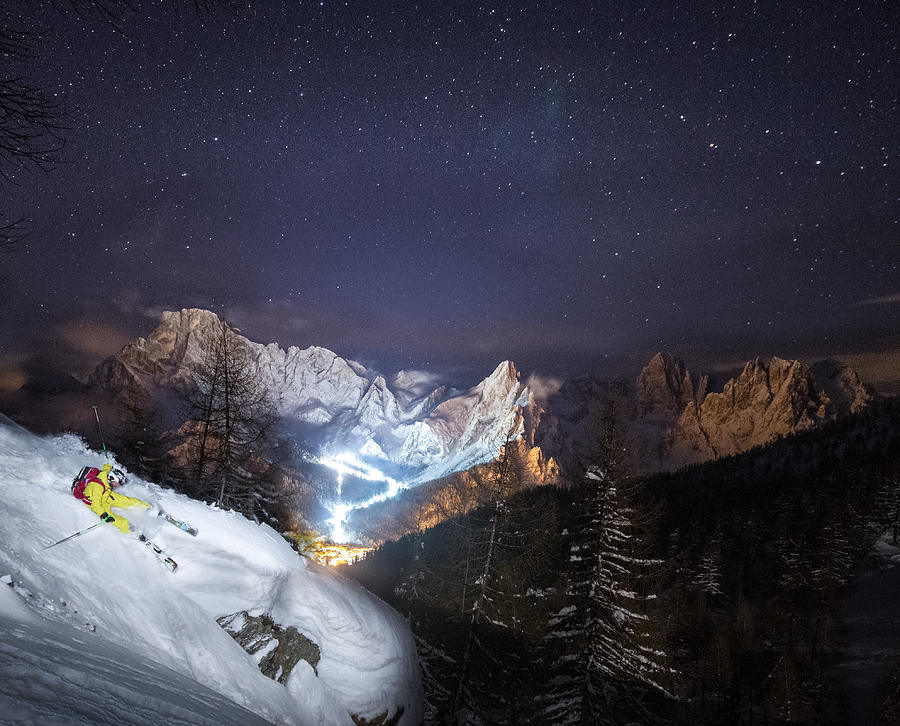 Winter Photograph - Skier Riding Down A Powder Slope At Night by Leander Nardin