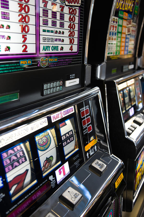 Color Image Photograph - Slot Machines At An Airport, Mccarran by Panoramic Images