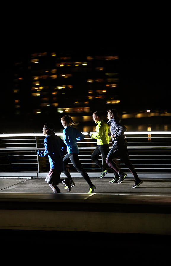 Small Group Of Runners Photograph by Henrik Sorensen