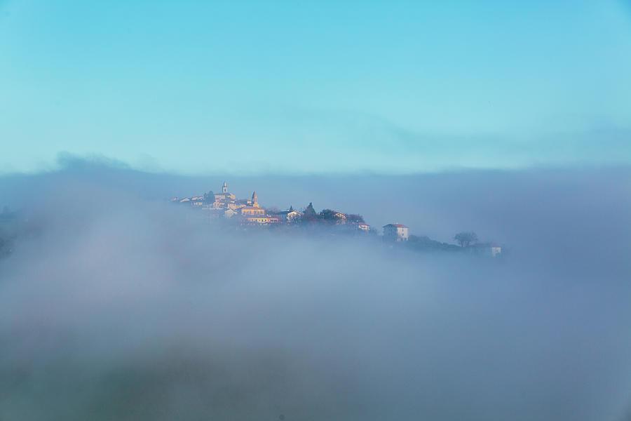 Small Italian Village In The Fog Photograph by Deimagine