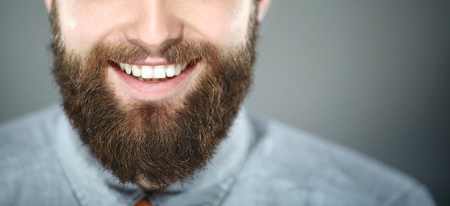 Smiling bearded man. Photograph by Gilaxia