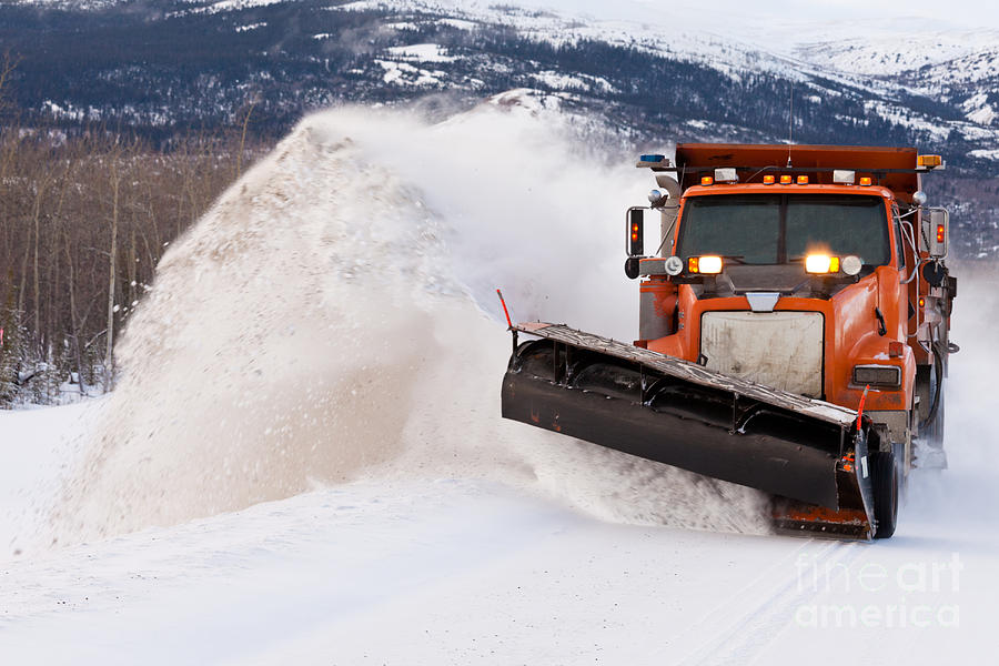 Blanketed Photograph - Snow Plough Clearing Road In Winter Storm Blizzard by Stephan Pietzko