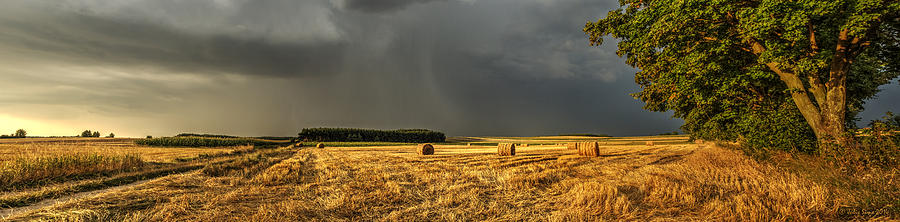 Storm Clouds Over Harvested Field In Poland Photograph
