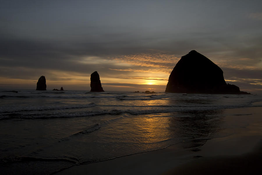 Sunset Photograph - Sunset over Haystack Rock in Cannon Beach by David Gn