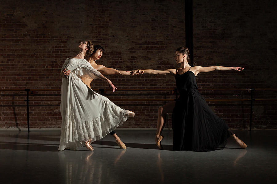 Three Ballet Dancers Performing Together Photograph by Nisian Hughes