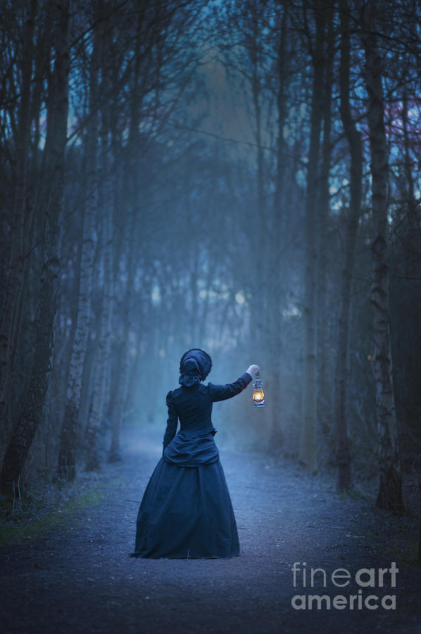 Victorian Or Edwardian Woman Holding An Oil Lamp At Night