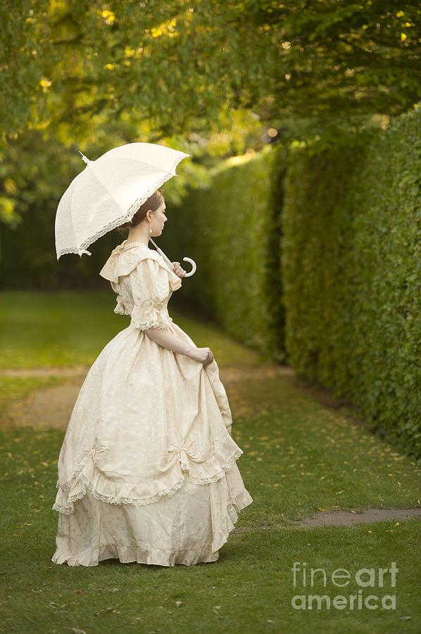 Victorian Woman Holding A Parasol In A Summer Garden
