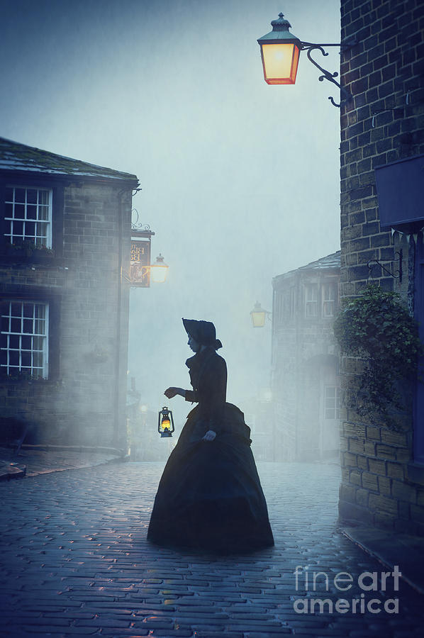 Victorian Woman With An Oil Lamp At Night On A Cobbled ...