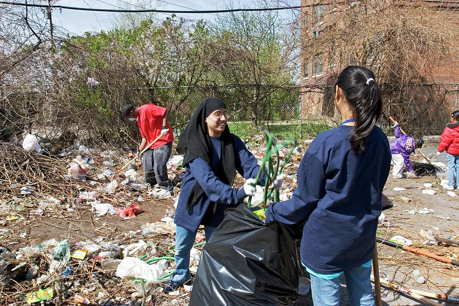 African-american Photograph - Volunteers Clearing Rubbish by Jim West